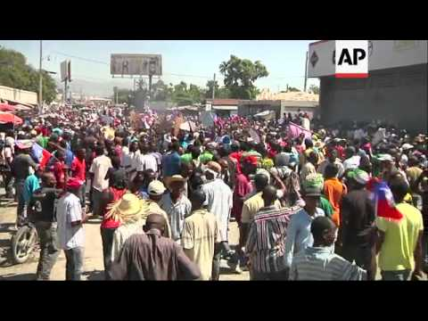 Supporters Of Former Haitian President Jean-Bertrand Aristide Scuffled With Riot Police On Tuesday A
