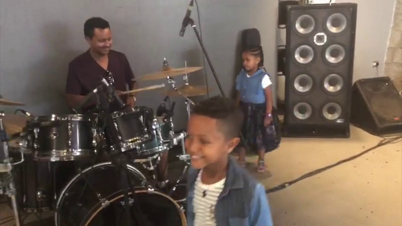 Teddy Afro With A Drum Having A Great Family Time