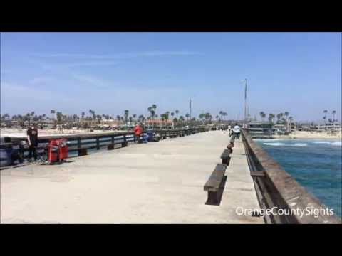 Walking along Newport Beach Pier in Newport Beach, California