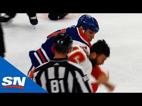 Milan Lucic Levels Travis Hamonic Then Drops The Gloves Against Anthony Peluso