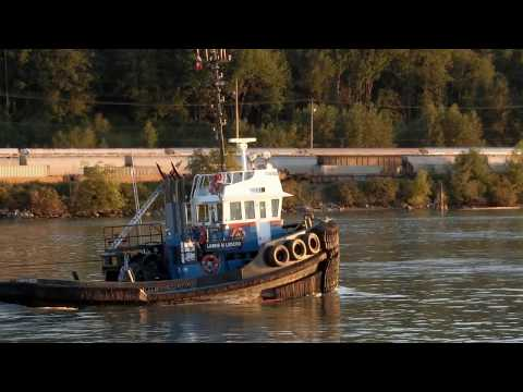 Lorne M Ledcor towing two gravel scows