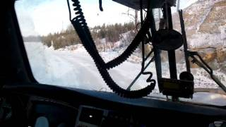 Tri-axle Dump truck pulling Quad Wagon Dump 65,000 kg (143,300lbs) out of oil rig