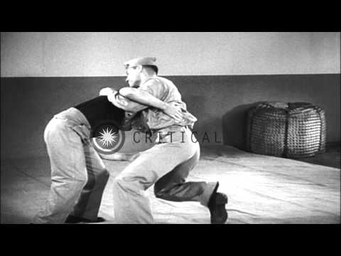 Sailors of the US Navy demonstrate chancery against low frontal attack, arm drag ...HD Stock Footage
