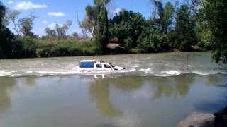 NT Police crossing Cahills Crossing at high tide.