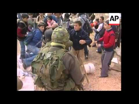 Palestinian children clash with soldiers at checkpoint