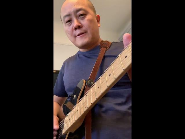 Rock school 101: Demonstrating side of the pick harmonics