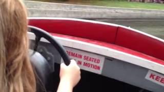 Zoe driving the motor boat at Knoebels
