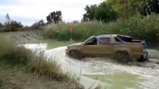 Chevrolet Avalanche off road in mud and water 4x4
