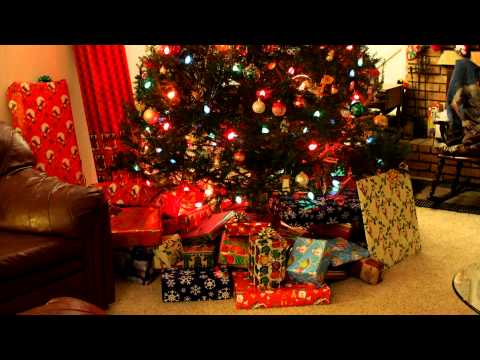 Putting gifts under the tree - time lapse