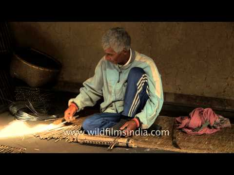 Old man making a fish trap in Manipur