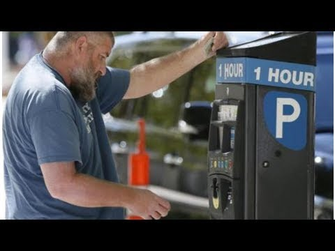 City replaces parking meters with electronic kiosks