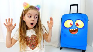 Ulya plays with new robot luggage suitcase traveling toy for the funny holidays