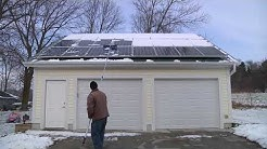 Using a Snow Rake on Solar Panels