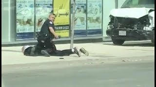 Toronto Police Confront And Arrest Man After Van Hits Pedestrians