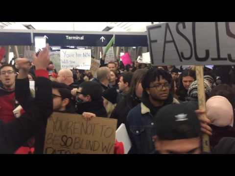 Thousands fill Detroit Metro Airport in protest