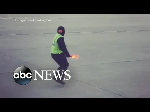 Curtis - Airline Worker Dances On Tarmac