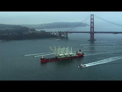 Massive Port of Oakland ship cranes transported under Golden Gate Bridge