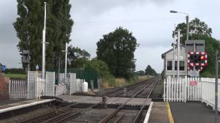 175108 passes Prees station and level crossing