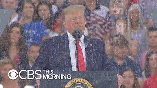 Trump avoids politics during rain-soaked Fourth of July celebration