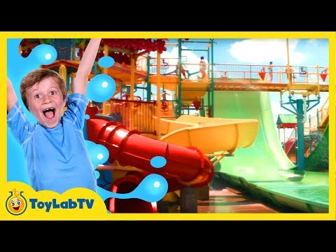 WATERPARK FUN While Getting Wet on Giant Water Slide Rides Race Challenge in Kids Family Fun Video