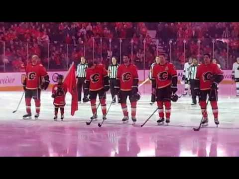Jesse leads the Flames onto the ice against the Sharks