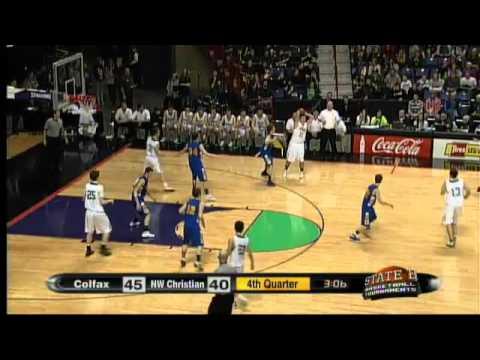 #10 Brandon Gfeller of Colfax High School drains a big three pointer as the shot clock goes off at t
