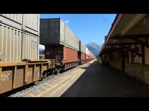 Two mile long double decker freight train runs through Banff