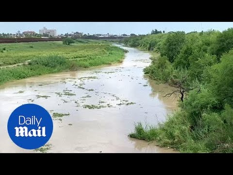 Father and daughter drown after being swept into river current