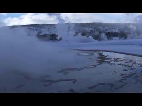 Geyser erupting in Yellowstone's winter