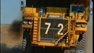 dump truck running over a four wheel drive in Queensland