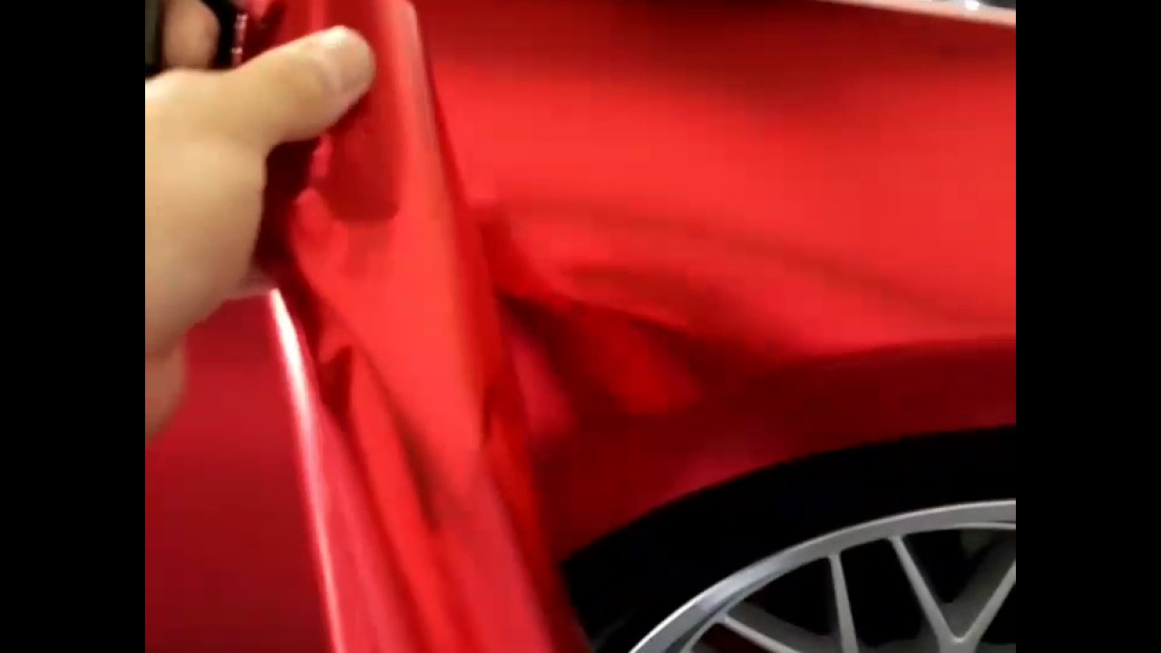 Vvivid Vinyl satin red chrome after 9 months in the sun (comparison) by  @CKWRAPS