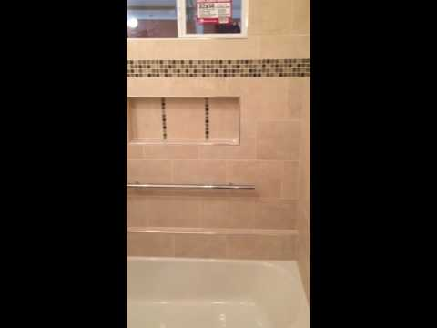 Columbia MO Custom tile tub surround with grab bar, window and niche ...