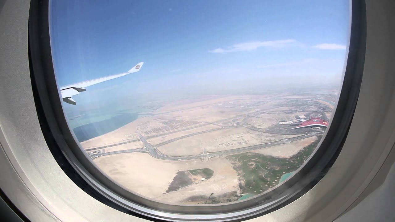 View from plane window Abu Dhabi airport and Ferrari World ...
