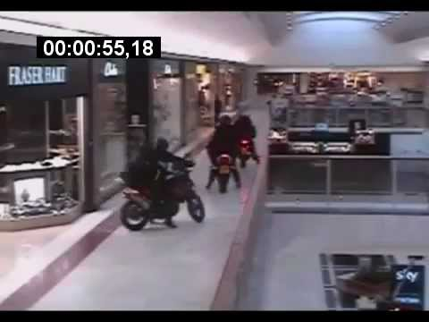 London robbery in a shopping mall with motorbikes.