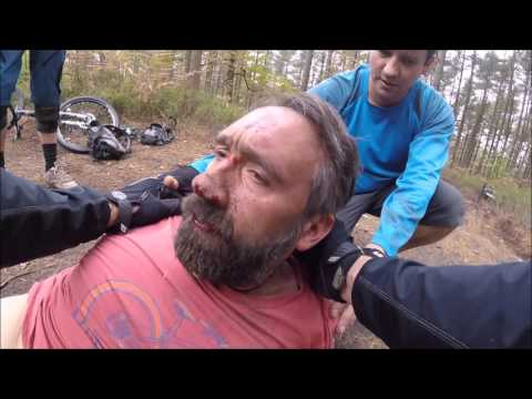 Over the bars mountain bike crash - Rider knocked unconscious.
