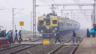 Old Vintage looking EMU Train Crossing busy Railgate through dense Fog in a Winter Morning   IR