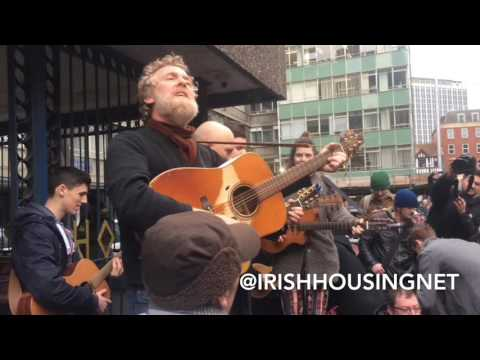 Glen Hansard performs outside of Apollo House