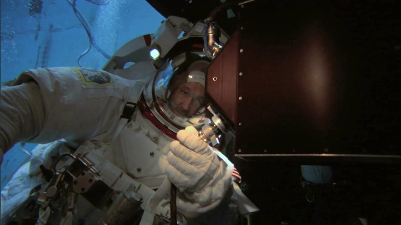 astronaut attaching hose