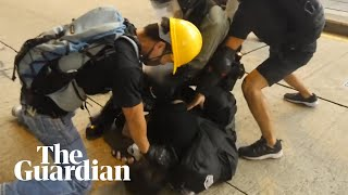 Bloody arrest by undercover police in Hong Kong