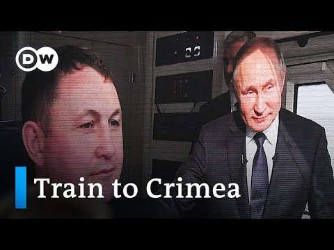 Putin opens railway bridge connecting Russia and Crimea | DW News