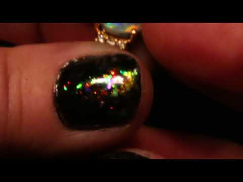 Solid black opal engagement ring 6 diamonds