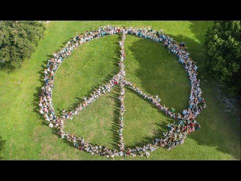 750 People Human Peace Sign For International Peace Day - Island Village Montessori School