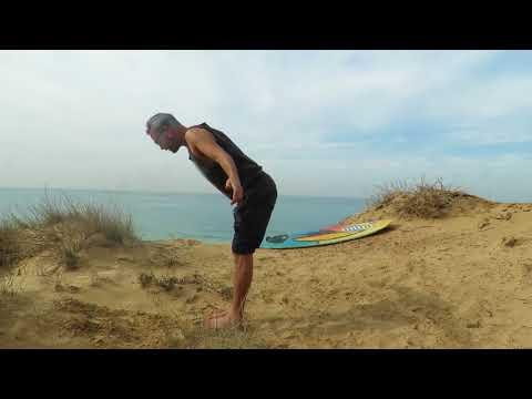 חימום יוגה לגלישה ,ברכה לשמש-עמית מנבר  בחוות הגלישה surf ranch israel