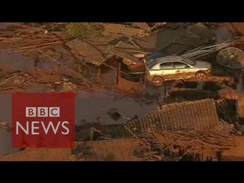Brazil dam burst: Rivers of thick red mud  - BBC News