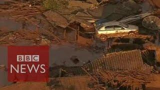 Brazil dam burst: Rivers of thick red mud  - BBC News