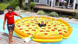 On a gonflé une pizza entière dans la piscine + Défi ,adel sami les boys tv