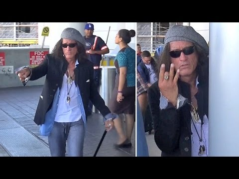 EXCLUSIVE - Aerosmith's Joe Perry Looking Slick At LAX