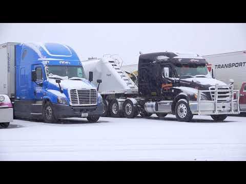11-26-2019 Rapid City, SD - Travelers Trucks Snowy I-90