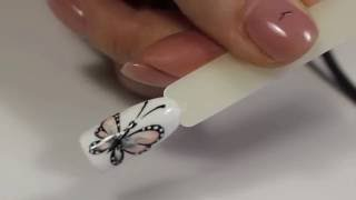 Как нарисовать бабочку на ногтях (видео)(Преподаватель курсов по маникюру и художественной росписи в Академии Стиля показывает, как сделать дизайн..., 2016-10-13T16:25:47.000Z)