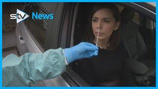 What happens during a drive-through coronavirus test?